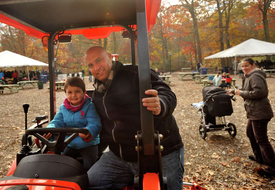 Tom Gallagher poses with his daughter, Olivia, during the sixth annual Stamford Charity Chili Cookoff at the Stamford Museum and Nature Center in Stamford, Conn., on Sunday, Nov. 3, 2013. Photo: Jason Rearick / Stamford Advocate