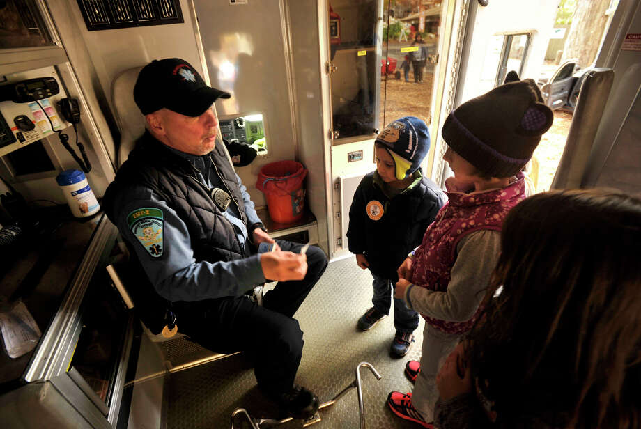Paul Moeller, an advanced emergency medical technician, quizzes children on basic safety and health issues in the back of an ambulance during the sixth annual Stamford Charity Chili Cookoff at the Stamford Museum and Nature Center in Stamford, Conn., on Sunday, Nov. 3, 2013. Photo: Jason Rearick / Stamford Advocate