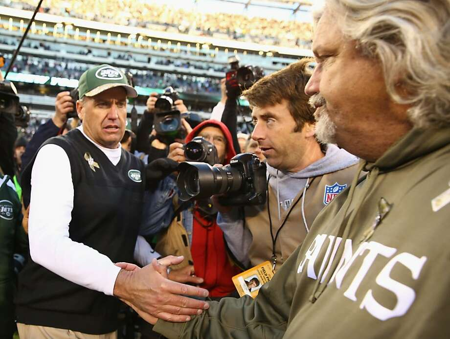 Jets coach Rex Ryan greets his brother, Saints defensive coordinator Rob Ryan, after the game. Photo: Al Bello, Getty Images