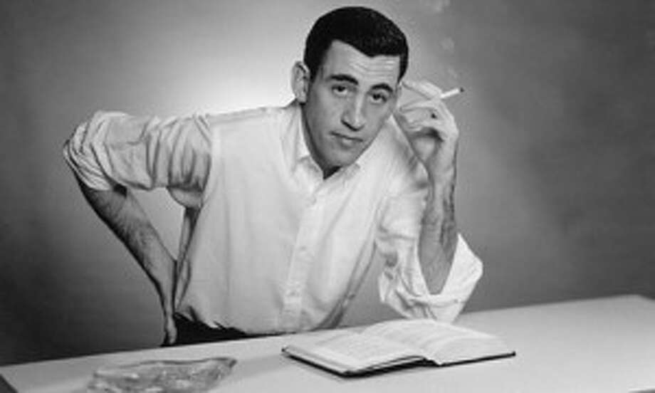 JD Salinger reading Catcher in the Rye in 1952 photo by Getty Images