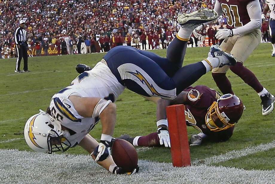 Chargers running back Danny Woodhead dives for the pylon but falls short against Washington and safety David Amerson. Photo: Alex Brandon, Associated Press