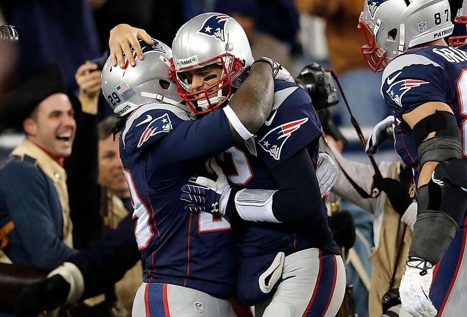 Tom Brady (right) celebrates with LeGarrette Blount after the two connected for a touchdown in the Patriots' 55-31 win over the Steelers. New England is now 7-2. Photo: Jim Rogash, Getty Images