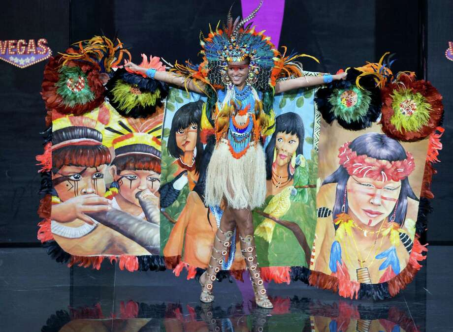 Miss Brazil Jakelyne Oliveira presents her outfit, during the national costume show at the 2013 Miss Universe pageant in Moscow, Russia, on Sunday, Nov. 3, 2013. Photo: Pavel Golovkin, Associated Press / AP