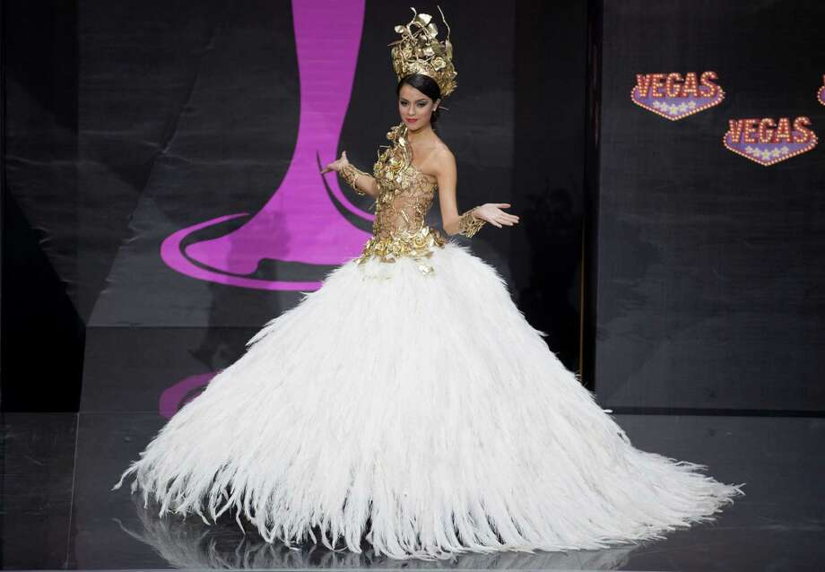 Miss Argentina Brenda Gonzalez presents her outfit, during the national costume show at the 2013 Miss Universe pageant in Moscow, Russia, on Sunday, Nov. 3, 2013. Photo: Pavel Golovkin, Associated Press / AP