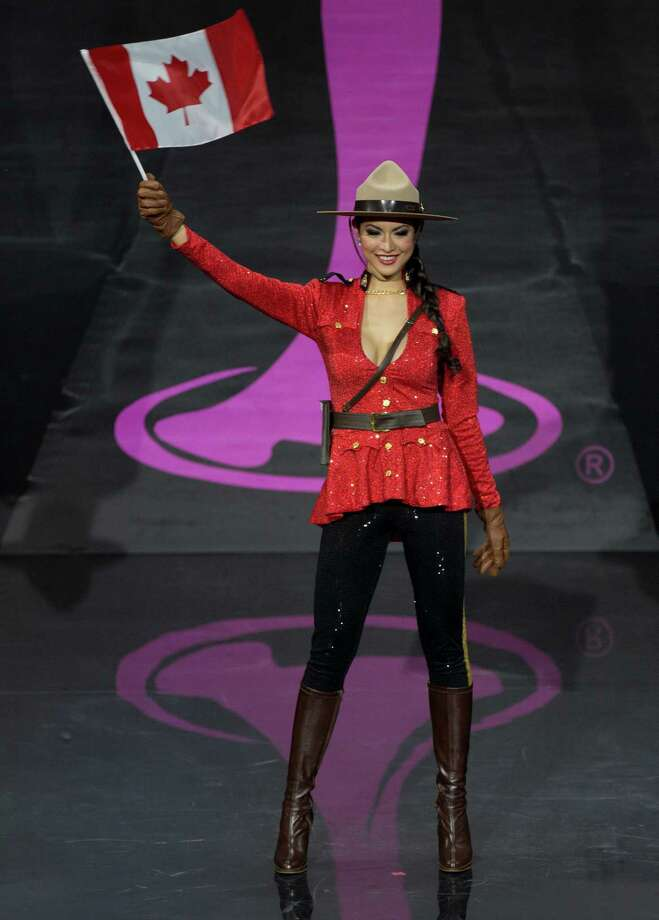 Miss Canada Riza Santos presents her outfit, during the national costume show at the 2013 Miss Universe pageant in Moscow, Russia, on Sunday, Nov. 3, 2013. Photo: Pavel Golovkin, Associated Press / AP