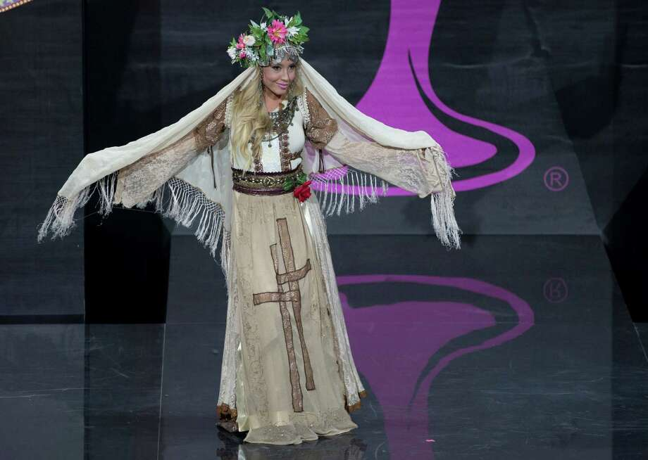 Miss Bulgaria Veneta Krasteva presents her outfit, during the national costume show at the 2013 Miss Universe pageant in Moscow, Russia, on Sunday, Nov. 3, 2013. Photo: Pavel Golovkin, Associated Press / AP