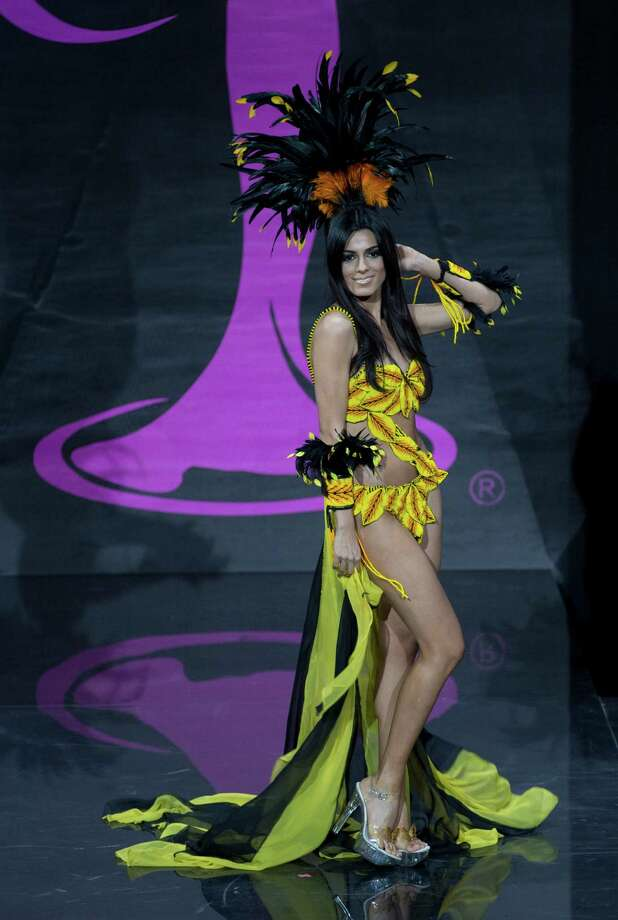 Miss Colombia Lucia Aldanapresents her outfit, during the national costume show at the 2013 Miss Universe pageant in Moscow, Russia, on Sunday, Nov. 3, 2013. Photo: Pavel Golovkin, Associated Press / AP