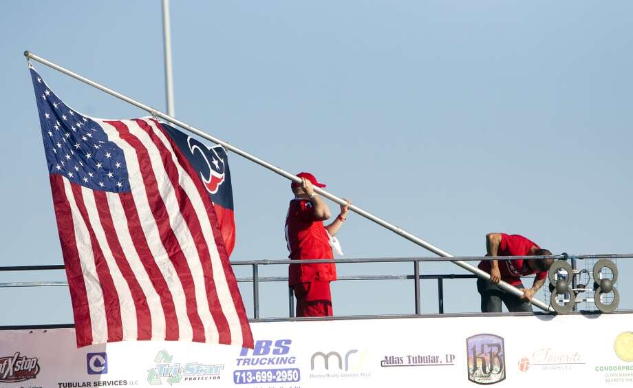 Houston Texans fan erect a flag pole containing the American and Texans flags before an NFL football game against the Indianapolis Colts at Reliant Stadium, Sunday, Nov. 3, 2013, in Houston. (Cody Duty / Houston Chronicle) Photo: Cody Duty, Houston Chronicle
