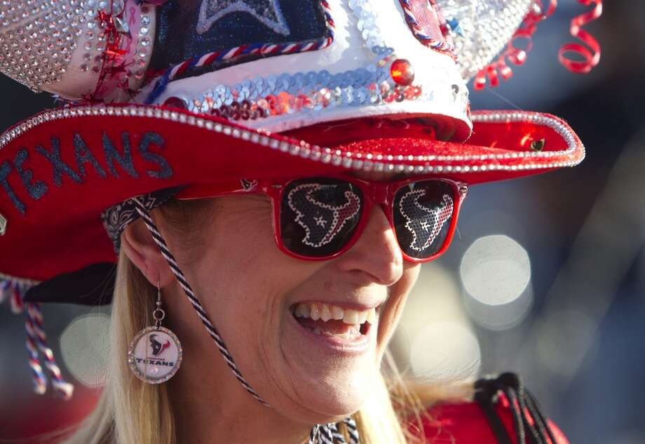 Houston Texans fan Pati Cream smiles under her fan gear  before an NFL football game against the Indianapolis Colts at Reliant Stadium, Sunday, Nov. 3, 2013, in Houston. (Cody Duty / Houston Chronicle) Photo: Cody Duty, Houston Chronicle