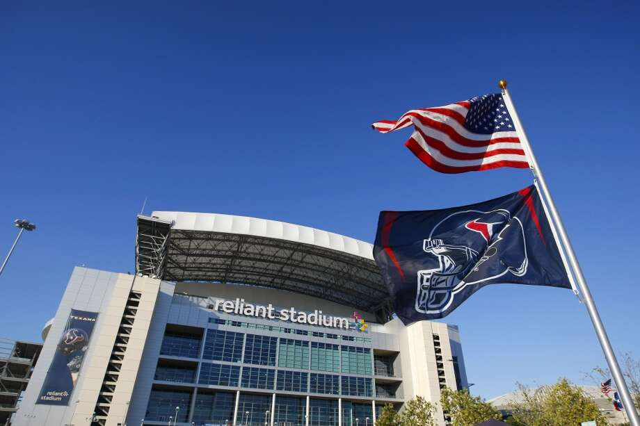 A Houston Texans flag flies under an American flag outside Reliant Stadium before an NFL football game against the Indianapolis Colts at Reliant Stadium, Sunday, Nov. 3, 2013, in Houston. (Cody Duty / Houston Chronicle) Photo: Cody Duty, Houston Chronicle