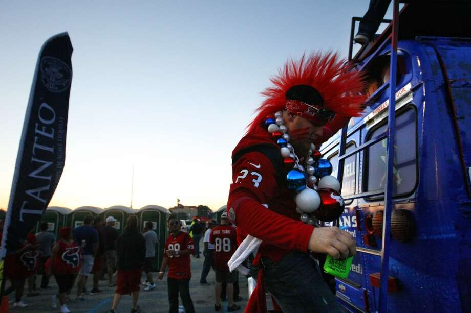 Jeffrey Mitchamore climbs down from a Houston Texans fan bus before an NFL football game against the Indianapolis Colts at Reliant Stadium, Sunday, Nov. 3, 2013, in Houston. (Cody Duty / Houston Chronicle) Photo: Cody Duty, Houston Chronicle