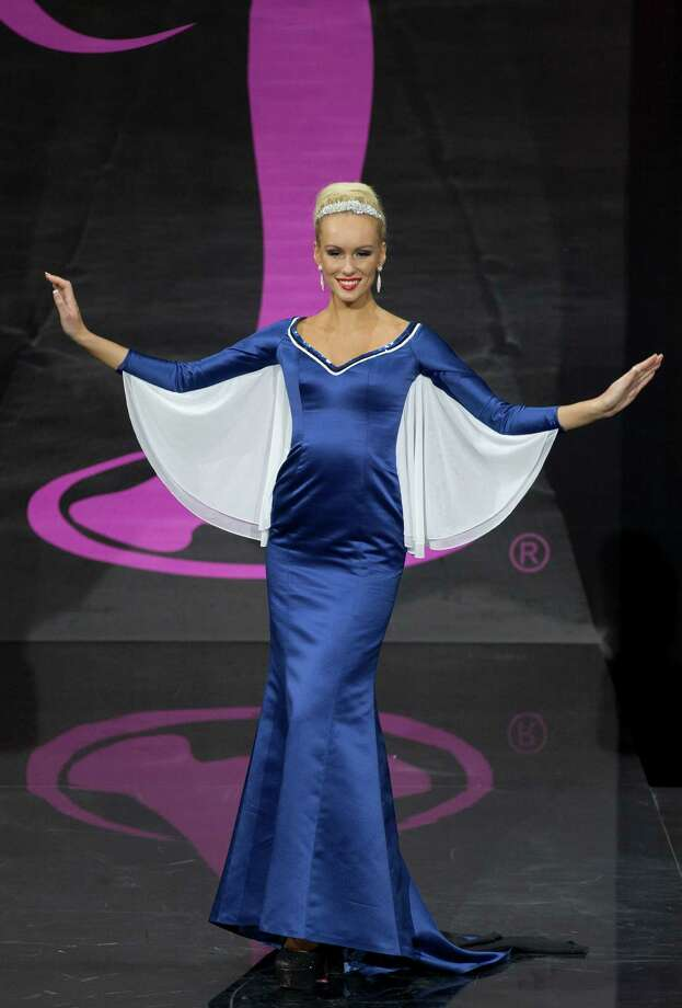 Miss Estonia Kristina Karjalainen presents her outfit, during the national costume show at the 2013 Miss Universe pageant in Moscow, Russia, on Sunday, Nov. 3, 2013. Photo: Pavel Golovkin, Associated Press / AP