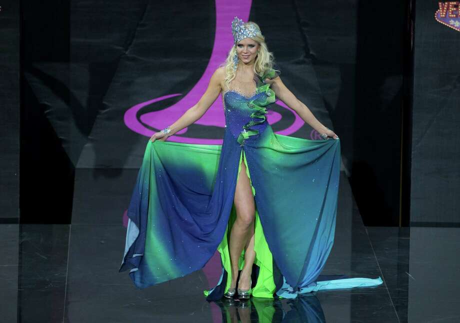 Miss Finland Lotta Hintsa's presents her outfit, during the national costume show at the 2013 Miss Universe pageant in Moscow, Russia, on Sunday, Nov. 3, 2013. Photo: Pavel Golovkin, Associated Press / AP