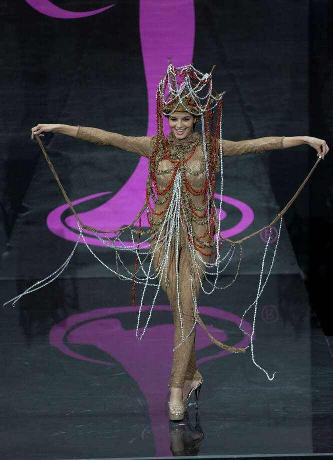 Miss  El Salvador  Alba Delgado presents her outfit, during the national costume show at the 2013 Miss Universe pageant in Moscow, Russia, on Sunday, Nov. 3, 2013. Photo: Pavel Golovkin, Associated Press / AP