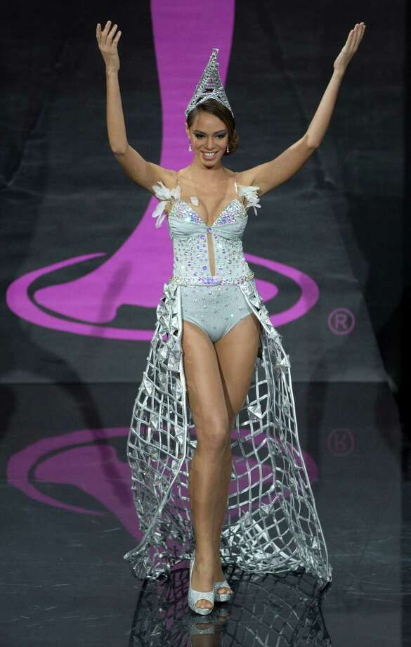 Miss France Hinarani de Longeaux presents her outfit, during the national costume show at the 2013 Miss Universe pageant in Moscow, Russia, on Sunday, Nov. 3, 2013. Photo: Pavel Golovkin, Associated Press / AP