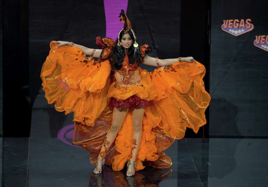 Miss Guyana Katherina Roshana presents her outfit, during the national costume show at the 2013 Miss Universe pageant in Moscow, Russia, on Sunday, Nov. 3, 2013. Photo: Pavel Golovkin, Associated Press / AP