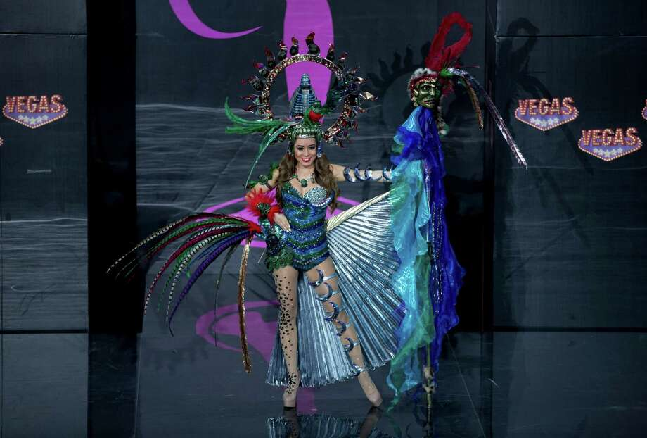 Miss Guatemala Paulette Samayoa presents her outfit, during the national costume show at the 2013 Miss Universe pageant in Moscow, Russia, on Sunday, Nov. 3, 2013. Photo: Pavel Golovkin, Associated Press / AP