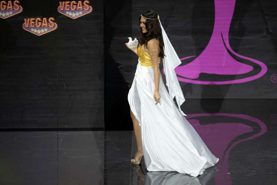 Miss Greece Anastasia Sidiropoulou's presents her outfit, during the national costume show at the 2013 Miss Universe pageant in Moscow, Russia, on Sunday, Nov. 3, 2013. Photo: Pavel Golovkin, Associated Press / AP