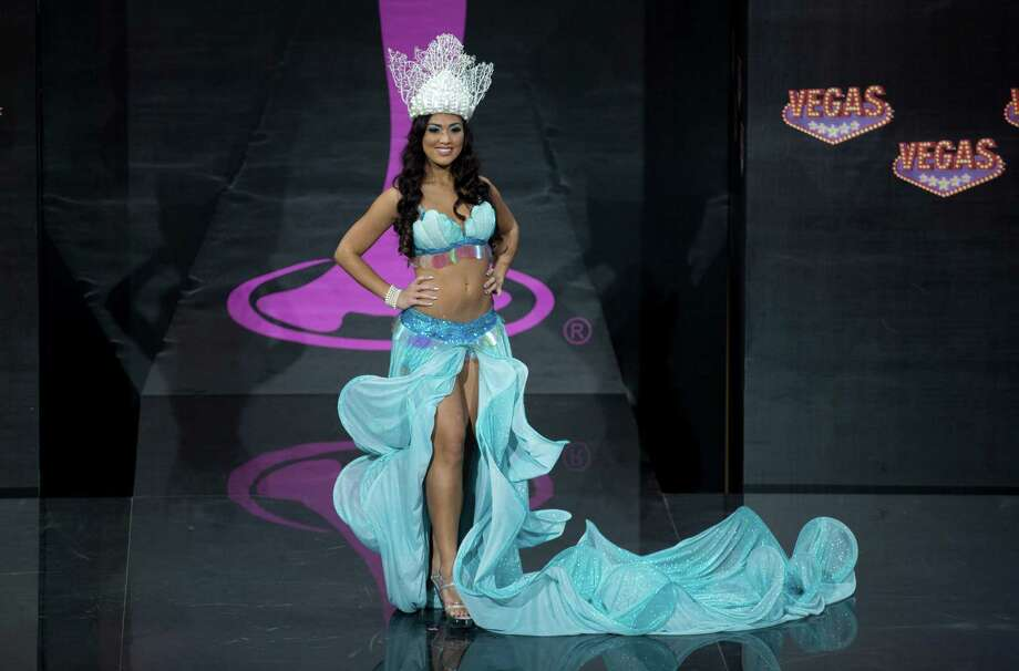 Miss Guam Alixes Scott presents her outfit, during the national costume show at the 2013 Miss Universe pageant in Moscow, Russia, on Sunday, Nov. 3, 2013. Photo: Pavel Golovkin, Associated Press / AP