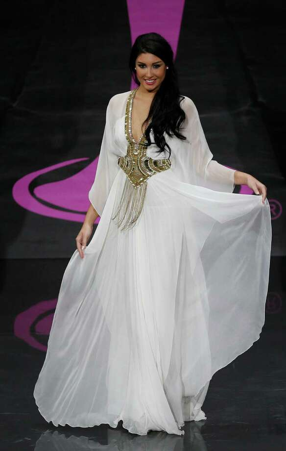 Miss Lebanon Karen Ghrawi presents her outfit, during the national costume show at the 2013 Miss Universe pageant in Moscow, Russia, on Sunday, Nov. 3, 2013. Photo: Pavel Golovkin, Associated Press / AP