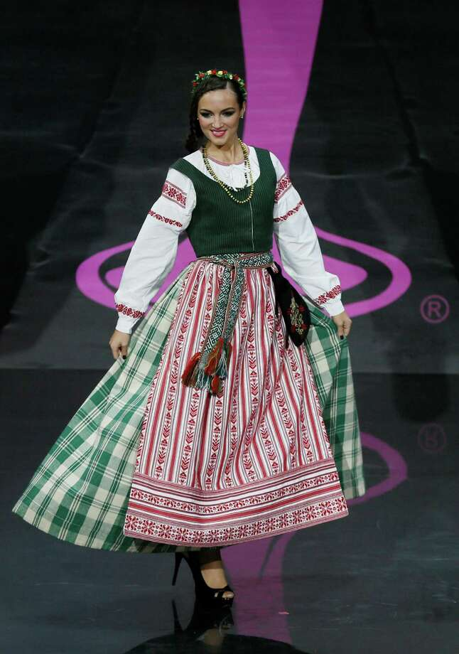 Miss Lithuania Simona Burbaite presents her outfit, during the national costume show at the 2013 Miss Universe pageant in Moscow, Russia, on Sunday, Nov. 3, 2013. Photo: Pavel Golovkin, Associated Press / AP