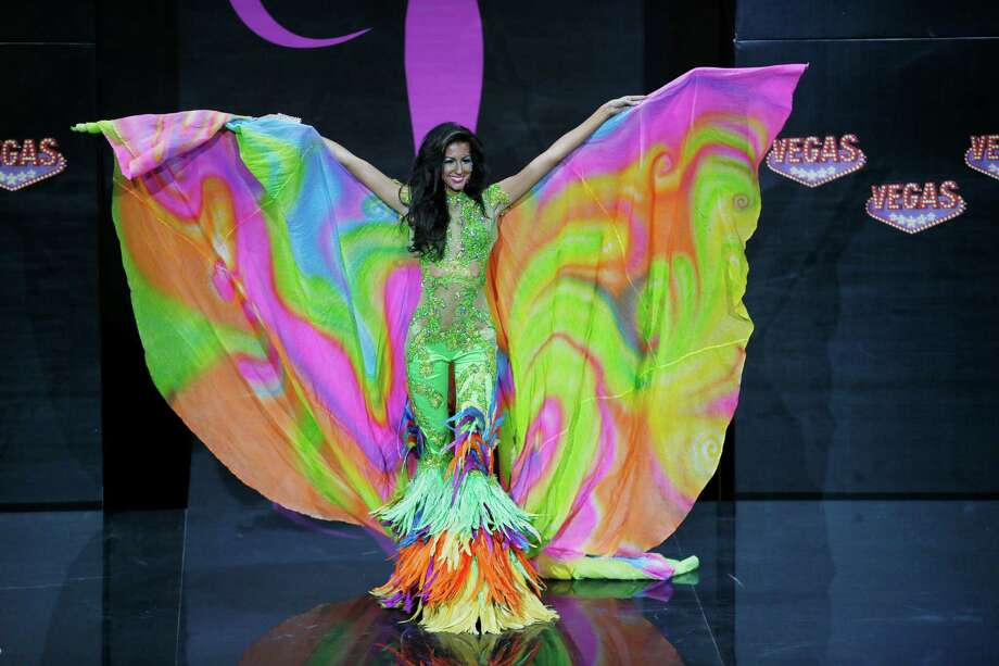Miss Jamaica Kerrie Baylis' presents her outfit, during the national costume show at the 2013 Miss Universe pageant in Moscow, Russia, on Sunday, Nov. 3, 2013. Photo: Pavel Golovkin, Associated Press / AP