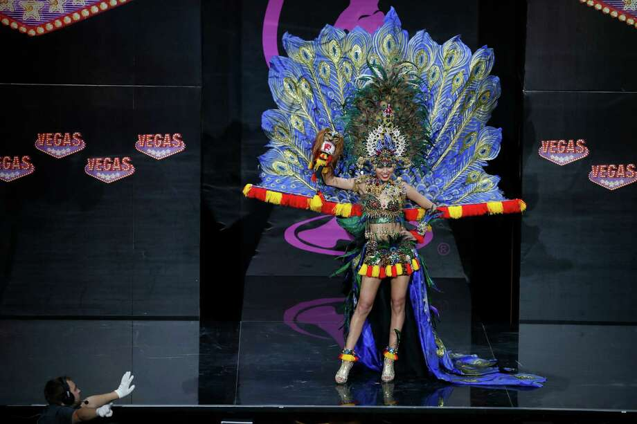Miss Indonesia Whulandary presents her outfit, during the national costume show at the 2013 Miss Universe pageant in Moscow, Russia, on Sunday, Nov. 3, 2013. Photo: Pavel Golovkin, Associated Press / AP