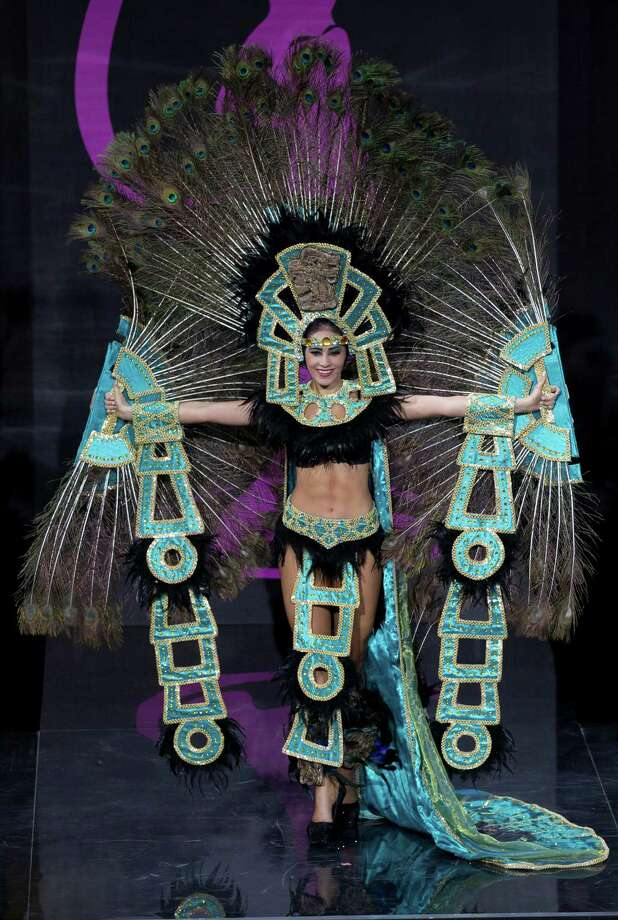 Miss Honduras Diana Schoutsen presents her outfit, during the national costume show at the 2013 Miss Universe pageant in Moscow, Russia, on Sunday, Nov. 3, 2013. Photo: Pavel Golovkin, Associated Press / AP