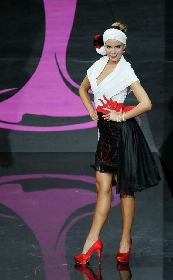 Miss Hungary Rebeka Kárpáti presents her outfit, during the national costume show at the 2013 Miss Universe pageant in Moscow, Russia, on Sunday, Nov. 3, 2013. Photo: Pavel Golovkin, Associated Press / AP