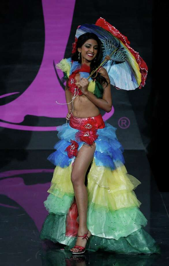 Miss  Mauritius Diya Beeltah presents her outfit, during the national costume show at the 2013 Miss Universe pageant in Moscow, Russia, on Sunday, Nov. 3, 2013. Photo: Pavel Golovkin, Associated Press / AP