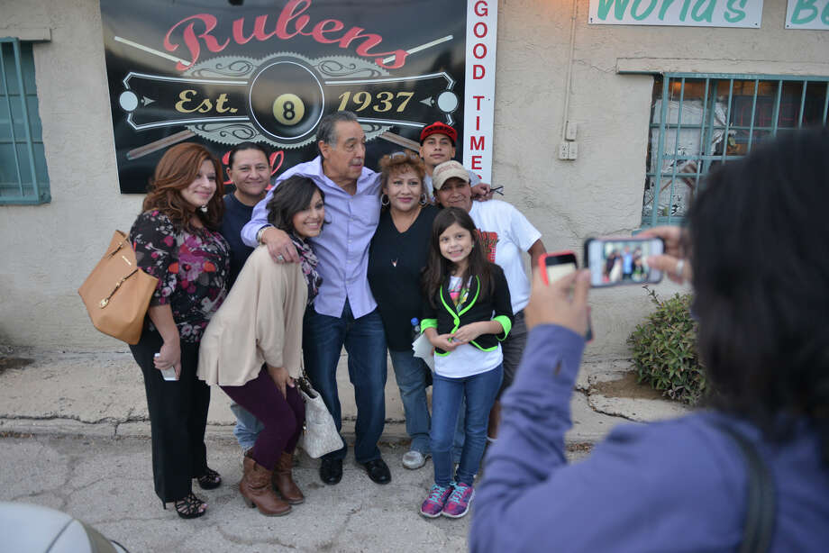 Ruben Castro (center) spent a lot of his evening posing for pictures with friends during Ruben's Place last night in business on Nov. 3, 2013. Photo: Robin Jerstad, For The San Antonio Express-News