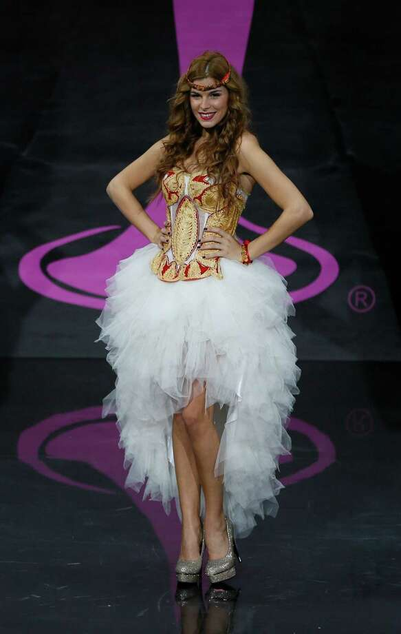 Miss Serbia Ana Vrcelj presents her outfit, during the national costume show at the 2013 Miss Universe pageant in Moscow, Russia, on Sunday, Nov. 3, 2013. Photo: Pavel Golovkin, Associated Press / AP