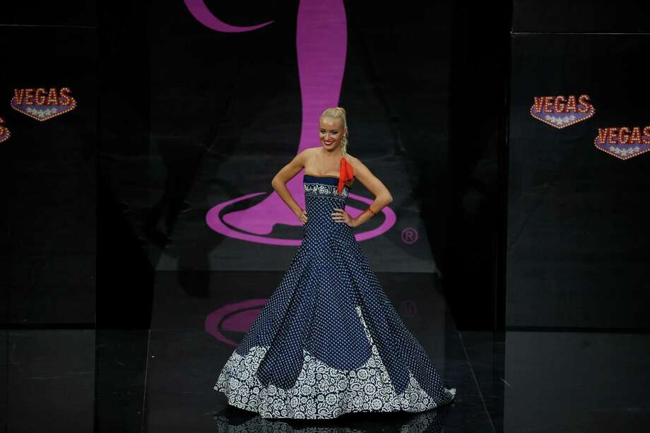 Miss Slovak Republic Jeanette Borhyová presents her outfit, during the national costume show at the 2013 Miss Universe pageant in Moscow, Russia, on Sunday, Nov. 3, 2013. Photo: Pavel Golovkin, Associated Press / AP