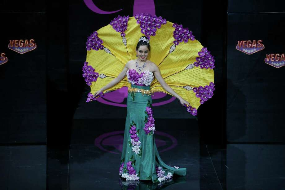 Miss Singapore Shi Lim presents her outfit, during the national costume show at the 2013 Miss Universe pageant in Moscow, Russia, on Sunday, Nov. 3, 2013. Photo: Pavel Golovkin, Associated Press / AP