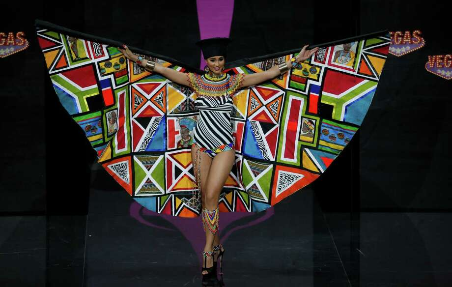 Miss South Africa Marilyn Ramos presents her outfit, during the national costume show at the 2013 Miss Universe pageant in Moscow, Russia, on Sunday, Nov. 3, 2013. Photo: Pavel Golovkin, Associated Press / AP