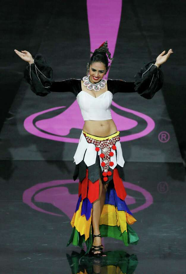 Miss Sri Lanka Amanda Ratnayake presents her outfit, during the national costume show at the 2013 Miss Universe pageant in Moscow, Russia, on Sunday, Nov. 3, 2013. Photo: Pavel Golovkin, Associated Press / AP