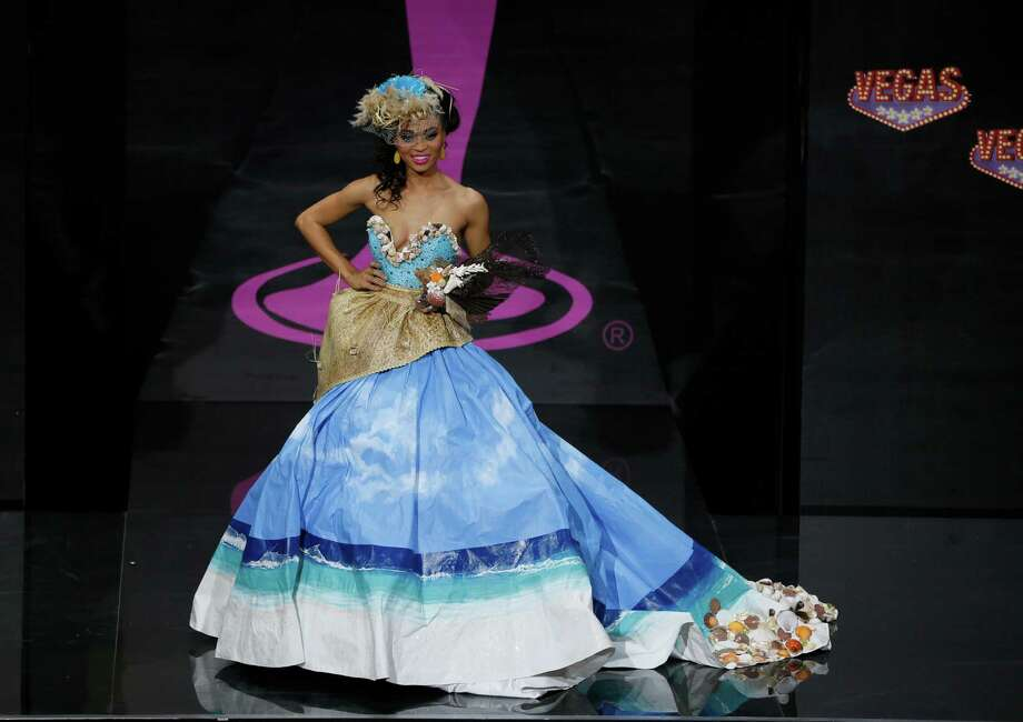 Miss Turks and Caicos Snwazna Adams presents her outfit, during the national costume show at the 2013 Miss Universe pageant in Moscow, Russia, on Sunday, Nov. 3, 2013. Photo: Pavel Golovkin, Associated Press / AP
