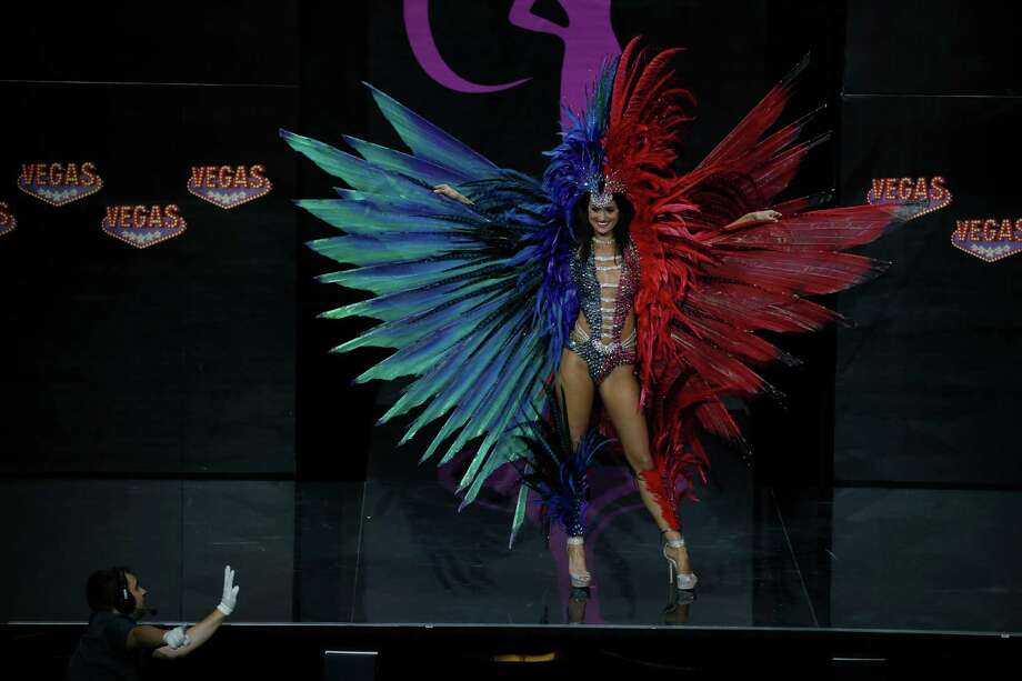Miss Trinidad and Tobago Catherine Miller presents her outfit, during the national costume show at the 2013 Miss Universe pageant in Moscow, Russia, on Sunday, Nov. 3, 2013. Photo: Pavel Golovkin, Associated Press / AP