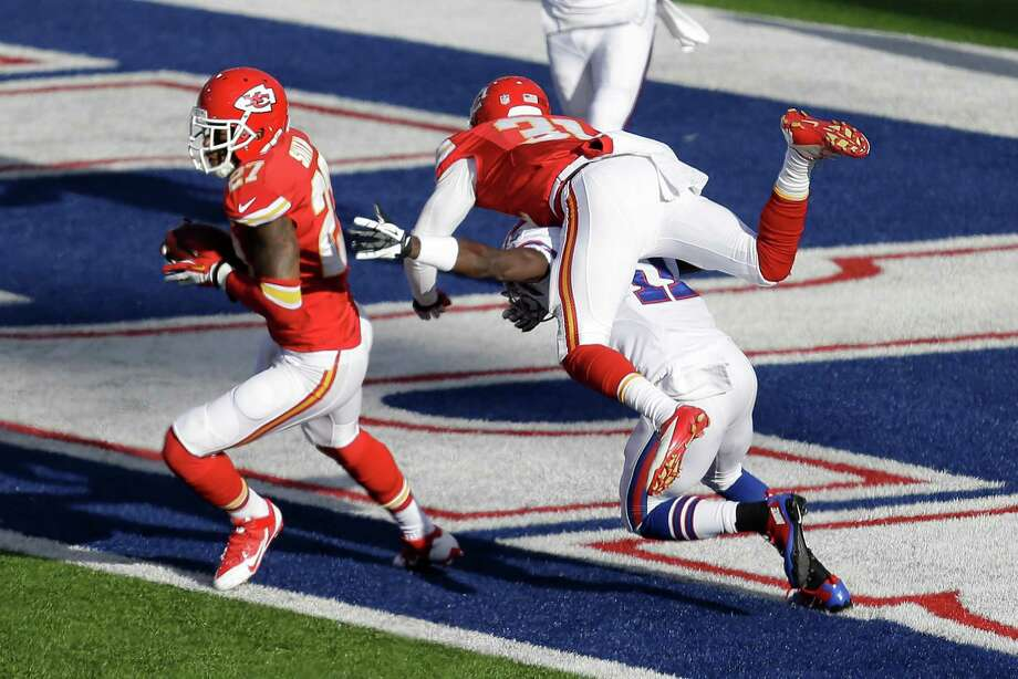 Kansas City Chiefs cornerback Sean Smith (27) intercepts a pass intended for Buffalo Bills wide receiver T.J. Graham (11) who is tackled by Kansas City Chiefs cornerback Marcus Cooper (31) in the endzone during the third quarter of an NFL football game in Orchard Park, N.Y. Sunday, Nov. 3, 2013.  Smith ran back the interception 101 yards for a touchdown. (AP Photo/Gary Wiepert) ORG XMIT: NYGP117 Photo: Gary Wiepert / FR170498 AP