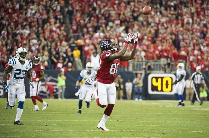 Texans wide receiver Andre Johnson catches a 62-yard touchdown pass from Case Keenum.