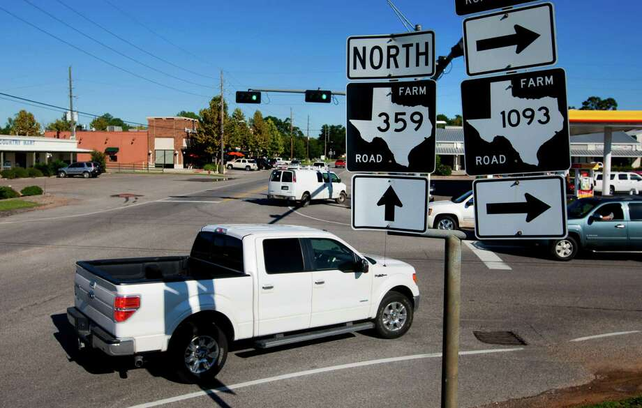 Drivers make their way through downtown Fulshear Friday, Nov. 1, 2013. Fulshear, a town way out from Houston's center, has become one of the region's fastest growing areas with a booming population from 400 in 2000 to 5,000 plus today. City and county leaders are working double time to keep up with the growth and that includes efforts to connect to major thoroughfares and widen its farm to market roads that wind through town. (Cody Duty / Houston Chronicle) Photo: Cody Duty, Staff / © 2013 Houston Chronicle