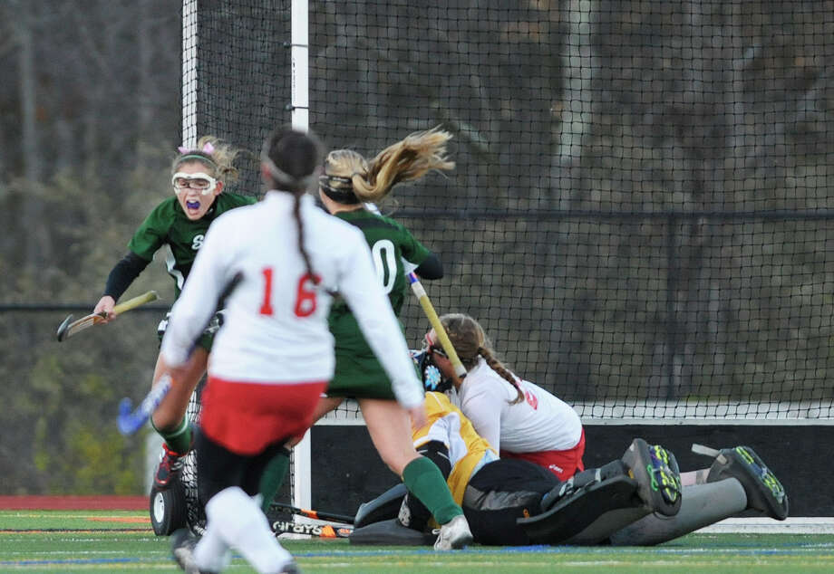 Anna Bottino, left, of Shenendehowa celebrates the first goal of the game against  Niskayuna during the Section II Class A field hockey final at Schuylerville High School on Sunday, Nov. 3, 2013 in Schuylerville, NY.  (Paul Buckowski / Times Union) Photo: Paul Buckowski