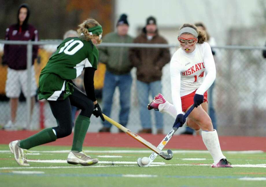 Morgan VanEpps of Shenendehowa, left, and  Ali Wells of Niskayuna battle for the ball  during the Section II Class A field hockey final at Schuylerville High School on Sunday, Nov. 3, 2013 in Schuylerville, NY.  (Paul Buckowski / Times Union) Photo: Paul Buckowski