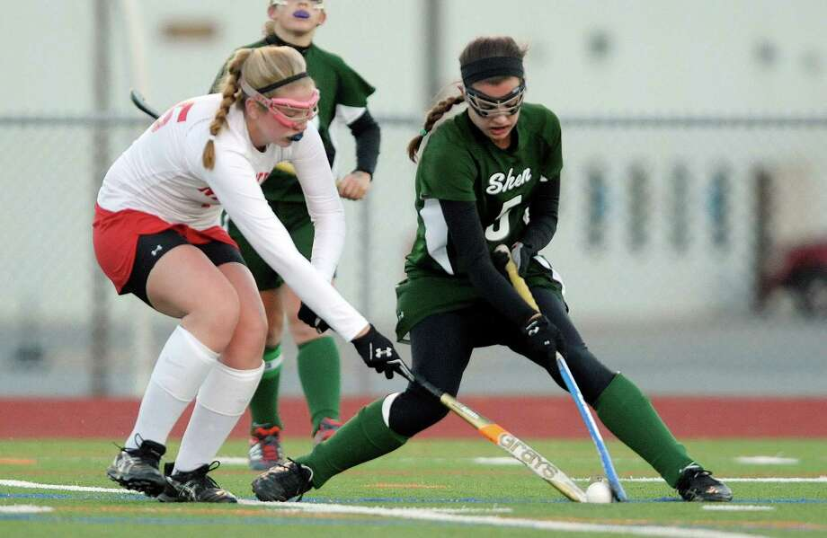 Kelsey Goldstoff of Niskayuna, left, and  Anna Branch of Shenendehowa battle for the ball during the Section II Class A field hockey final at Schuylerville High School on Sunday, Nov. 3, 2013 in Schuylerville, NY.  (Paul Buckowski / Times Union) Photo: Paul Buckowski