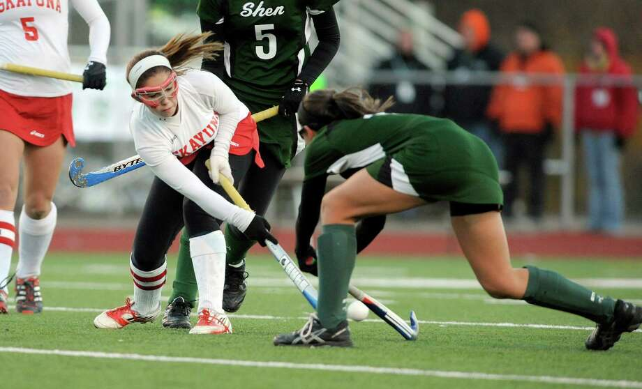 Ali Frary of Niskayuna, left, passes the ball past  Nicole DaCunha of Shenendehowa during the Section II Class A field hockey final at Schuylerville High School on Sunday, Nov. 3, 2013 in Schuylerville, NY.  (Paul Buckowski / Times Union) Photo: Paul Buckowski