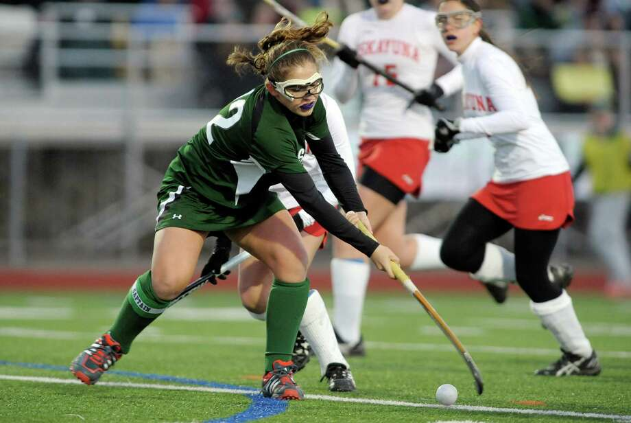 Anna Bottino of Shenendehowa brings the ball up the filed past Niskayuna players during the Section II Class A field hockey final at Schuylerville High School on Sunday, Nov. 3, 2013 in Schuylerville, NY.  (Paul Buckowski / Times Union) Photo: Paul Buckowski