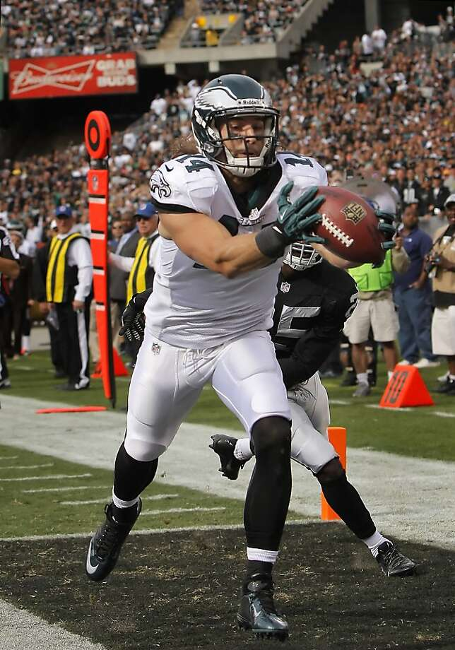 The Raiders allowed seven touchdown passes Sunday, including a second-quarter grab by the Eagles' Riley Cooper, in their loss. Photo: Carlos Avila Gonzalez, The Chronicle
