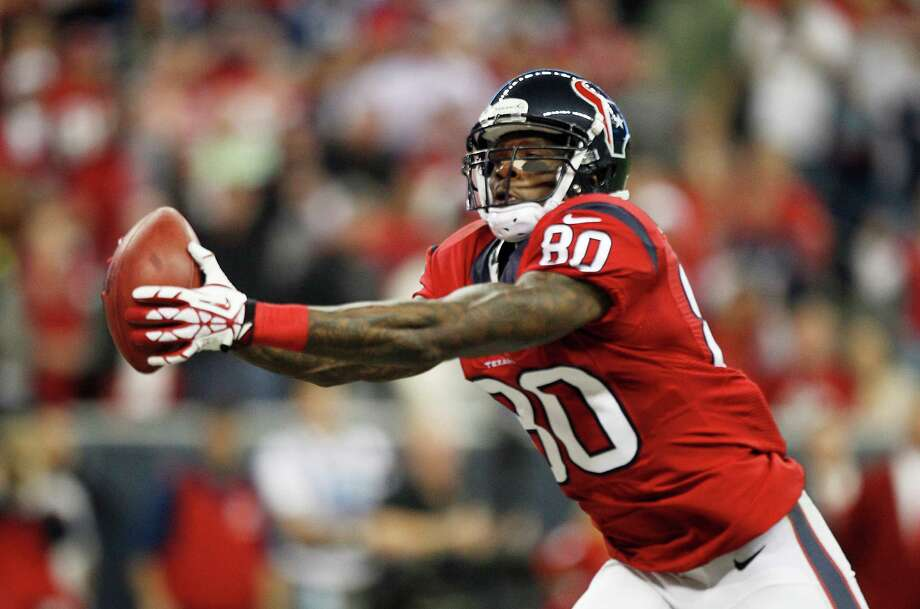 Houston Texans wide receiver Andre Johnson (80) catches a 41-yard touchdown pass during the first quarter at Reliant Stadium on Sunday, Nov. 3, 2013, in Houston. Photo: Brett Coomer, Houston Chronicle / © 2013  Houston Chronicle