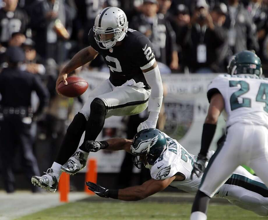 Terrelle Pryor avoids a tackle by Philadelphia's Nate Allen on a short scramble in the second quarter. The Oakland Raiders played the Philadelphia Eagles at O.co Coliseum in Oakland, Calif., on Sunday, November 3, 2013. Photo: Carlos Avila Gonzalez, The Chronicle