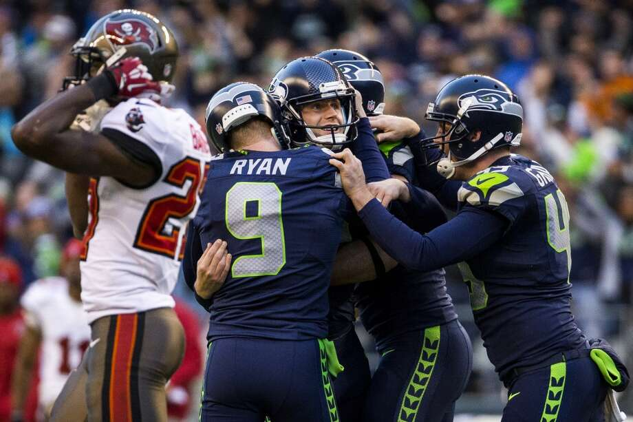 Seahawks kicker Steven Hauschka, center, is swarmed by teammates after kicking in the winning field goal against the Buccaneers in overtime Sunday, Nov. 3, 2013, at CenturyLink Field in Seattle. The Seahawks beat the Buccaneers 27-24 in the biggest comeback in franchise history. (Jordan Stead, seattlepi.com) Photo: JORDAN STEAD, SEATTLEPI.COM